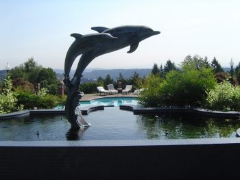 pool with dolphin statues